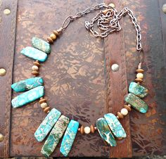 Ocean jasper, snake jasper gemstone, wood  and copper metal necklace. Green, blues, browns and creams with antiqued copper.