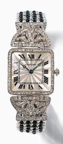 #ArtDeco platinum, onyx, and diamond watch by #Cartier, circa 1912.