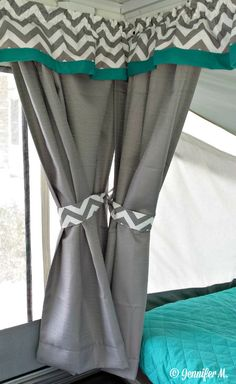 Clip off the hardware from your original camper curtains and save it.  It can be reused to hang updated panels and valances.