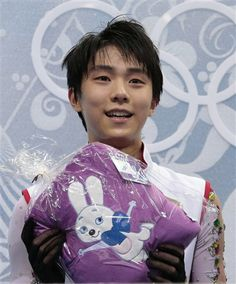 Yuzuru Hanyu of Japan holds an item given to him by a spectator as he sits in the results area after the men's free skate figure skating final at the Iceberg Skating Palace at the 2014 Winter Olympics, Friday, Feb. 14, 2014, in Sochi, Russia. (AP Photo/Ivan Sekretarev) ▼14Feb2014 AP|Japanese teen Hanyu wins Olympic gold, wants more http://wintergames.ap.org/article/japanese-teen-hanyu-wins-olympic-gold-wants-more