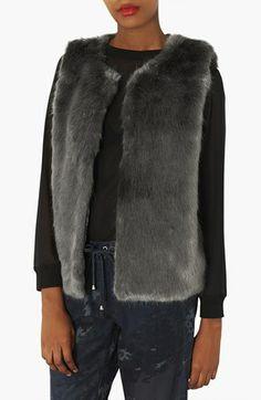 Loving this faux fur vest.
