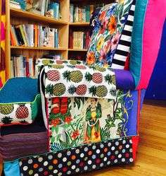 View from Frida's side of the amazing Carnival upcycled chair by @lizad_art ... brings both life and comfort to your reading nook!  #art #upholstery #chair #ottoman #upcycle #recycle #macaws #pineapples #polkadots #fridakahlo #blarneybooksandart #portfairy by blarneybooks http://ift.tt/1UokfWI