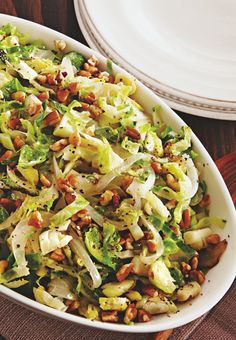 Caramelized onion, pecans and Brussels sprouts make a delicious side salad for the big feast. Delicious served warm or at room temperature!