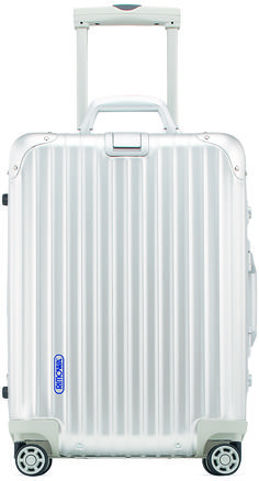 "Silver Fox. Rimowa Topas silver 29"" multi-wheel may be lightweight, but it packs plenty. $1,130. At @bloomingdales"