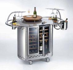 Mesa para vino, by ALPINA Group sa  Fabricada en acero inoxidable, móvil y con capacidad de 21 botellas de vino por lado, que se enfría a distinta temperatura.