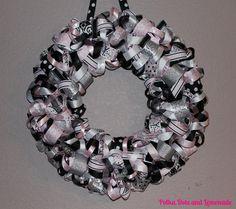 ribbon wreath tutorial using dressmaker pins to secure ribbon loop to styroform.