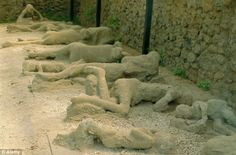Body casts of people who were citizens of Pompeii, Italy that were buried in volcanic ash when Mt. Vesuvius erupted in 79 AD wiping out the entire city and everyone in it.  Estimates are 10,000 - 20,000 people were entombed in ash.