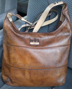 Coach bag after dying, now a gorgeous distressed leather. Left the patent handle as is because it was in great shape and matches the front logo.