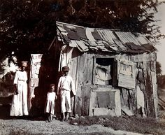 """Description: Photograph taken to demonstrate some of the worst housing conditions in British Antigua. The island was in the process of carrying out slum clearance. The file reads """"I believe I am correct in stating that, nowhere in the British West Indies, are the working people more wretchedly housed and more detached from the land than in Antigua.""""    Date: 1914 How Can I Sleep, British West Indies, Water Island, St Vincent Grenadines, House Proud, Virgin Gorda, We Are Festival, West Indian, Slums"""