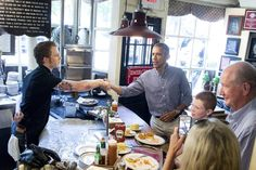 President Obama greets people at Boston's Union Oyster House on Monday, the same day he...
