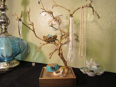 DIY jewelry tree. I absolutely LOVE the bird's next for rings.