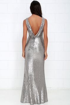 Lulus Exclusive! Shimmer with every step you take in the Slink and Wink Matte Silver Sequin Maxi Dress! A rounded neckline and sexy cowl back top a darted, sleeveless bodice. Small matte sequins travel gracefully down a straight-cut maxi skirt. Hidden side zipper with clasp.