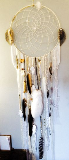 Huge white-on-white #dreamcatcher with reclaimed #fox fur tail and #vintage trims, available on my Etsy store: https://www.etsy.com/listing/168507280/huge-white-dreamcatcher-with-fox-fur