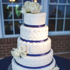 Navy & White Wedding Cake // photo: Trivium Studio / Cake: Shockley's Sweet Shopper / http://www.theknot.com/weddings/album/a-modern-southern-wedding-in-virginia-beach-va-131552