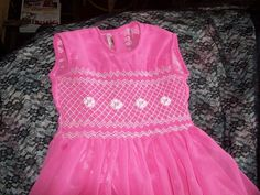 size 4 to 5 long smocked crepe gown with hand embroidery on hem and chest