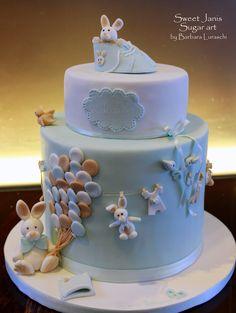 Edoardo's Christening cake - I made this cake for the christening of little Edoardo. Vanilla cake filled with white chocolate ganache and raspberries. Sugar paste decorations handmade. Hope you like it :-) xxx