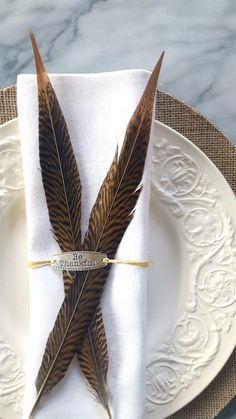 """I wanted something personal for each guest, so the idea of the gorgeous pheasant feathers and """"Be Thankful"""" charms wrapped up together for each place setting was perfect! Thanksgiving Table Settings, Thanksgiving Tablescapes, Holiday Tables, Christmas Tables, Thanksgiving Ideas, Holiday Parties, Look Retro, Vintage Stil, Fall Table"""