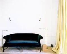 Jo Malone London - A velvet sofa flanked by two floor lamps