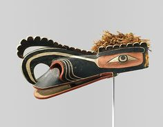 Crooked Beak of Heaven Mask Date: late 19th century Geography: Canada, British Columbia Culture: Kwakwaka'wakw (Kwakiutl) Medium: Wood, plant fiber, cord, pigment Dimensions: H. 18 1/4 x L. 40 1/8 in. (46.4 x 101.9 cm) Classification: Wood-Sculpture Collection, Gift of Ralph T. Coe Foundation for the Arts, 2011 MMA Accession Number: 2011.154.4