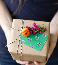 Decorate your next gift with fresh or dried flowers.