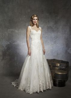 Justin Alexander wedding dresses style 8653 A-line gown of beaded lace on a tulle sweetheart neckline with cap  sleeves. A V-back with buttons covering the back zipper and style has a  chapel length train.