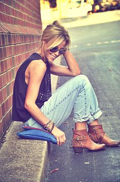 black embellished shirt/t, rolled/cuffed jeans, boots
