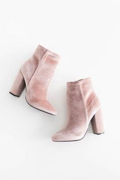 """High ankle booties with a velvet texture. Side zipper for easy on and off closure. Heel height measures approx. 4"""" Slightly pointed toe. This style runs small,"""