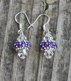 Swarovski Lavender Bling Earrings $12.00 If you need a lot of bling these are the earrings to have!  These beauties are made with clear 6mm aurora borealis Swarovski crystal bicones and lavender and clear rhinestone beads on .925 sterling silver fish hooks.
