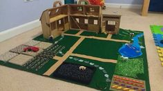Farm play mat with sample carpet squares, felt, and decorative fabric