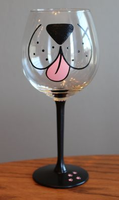 This simple yet adorable red wine glass is the perfect gift for any dog lover, and even makes them look like their favorite animal while