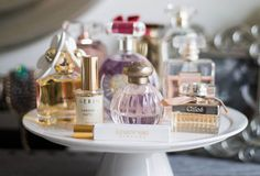 Keep your fragrances on display using a cake stand, a Lucite tray or a spice rack. Those bottles aren't meant to be hidden.