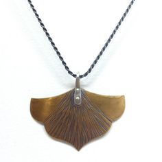I fell in love with this shape the moment I saw it, and bought the necklace and matching earrings. I love them so much, I wear mine all the time and get so many compliments on them it's ridiculous.   Large Mieka Necklace  Floral Hammered Bronze by MidnightPacific on Etsy  https://www.etsy.com/listing/211551388/large-mieka-necklace-floral-hammered?ref=shop_home_active_1