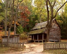 The Tipton cabin in Cades Cove, Great Smoky Mountains, Tennessee is surrounded by autumn foliage. The old rail fence adds to the rustic scene from days gone by. Old Cabins, Cabins And Cottages, Cabins In The Woods, Abandoned Houses, Old Houses, Cabana, Smoky Mountain National Park, Smokey Mountain, Smoky Mtns