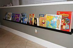 Easy Book storage using IKEA picture shelves! Ikea Picture Shelves, Modern Playroom, Playroom Ideas, Nursery Ideas, Handmade Bookshelves, Leather Strap Shelves, Metal Lockers, Comfortable Pillows, Shelves In Bedroom