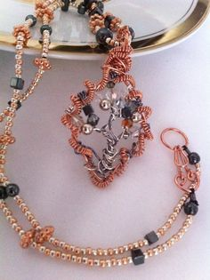 Copper & Hematite Tree Of Life is diamond shape with Swarovski crystals, and hand beaded necklace is premium glass beads with copper & hematite accents.