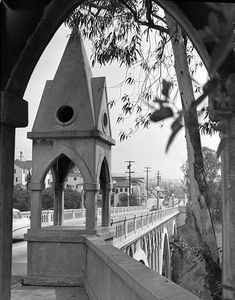 (1956)^* - View of the Shakespeare Bridge through one of its eight ornate Gothic copulas.