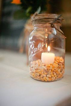 Mason Jar, Popcorn Kernels & a votive... Simple and perfect for any isle, lighted pathway or add some flowers and a wood disk and you have a beautiful centerpiece for your Fall event