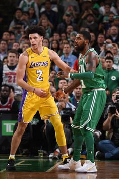 Lonzo Ball of the Los Angeles Lakers and Kyrie Irving of the Boston Celtics stand on the court during the game on November 8 2017 at the TD Garden in...