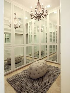 Marie Flanigan Interiors: Chic closet with floor to ceiling mirrored doors and travertine tile closet  floors. ...