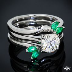 This Custom Ring Guard is set in platinum and features 4 Marquise Cut Emeralds.   Register with Whiteflash and get $75.00 off your first order    whiteflash.com