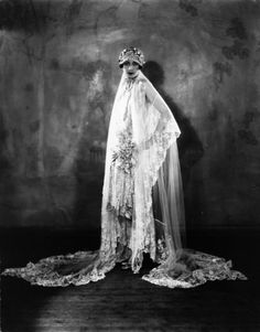 1926 - A model wearing a wedding dress from the Solosign fashion house.