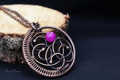 Copper wire wrapped necklace with purple faceted jade bead