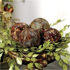 .I have pheasant feather covered balls, I've used them in bowls and on the Christmas tree.