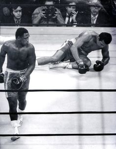 Joe Frazier knocks down Muhammad Ali in the 15th round of their first fight, March 8, 1971. Frazier won the undisputed heavyweight title with a 15-round unanimous decision over Ali at Madison Square Garden in an extravaganza known as the Fight of the Century.