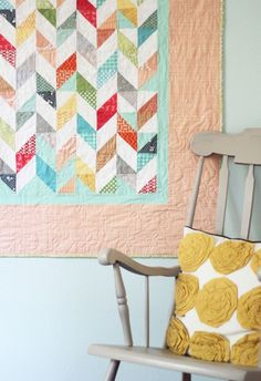 After hanging on the wall for a week I decided to make my colorful mini-quilt into a quilt for Sophie. My husband thought the 4 quilts she has are already enough. Psshhh….there is no such thing a…