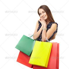 Woman with colorful shopping bags ...  attractive, background, bag, beautiful, buying, carrying, caucasian, cheerful, colorful, consumerism, customer, cute, delight, dreaming, elegance, enjoying, excitement, female, friendly, fun, gift, girl, hand, happy, holding, ideas, isolated, joy, lady, leisure, looking, luxury, multi, paper, people, pleasure, portrait, positivity, pretty, purchase, retail, sale, shopaholic, shopping, smiling, standing, success, white, woman, young