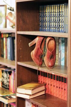 shoes in a bookcase