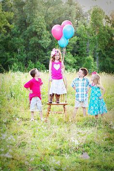 kids photography poses and props could easily with just the girl in the middle holding the balloons.