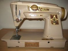Looks just like my machine. Singer from 1961.