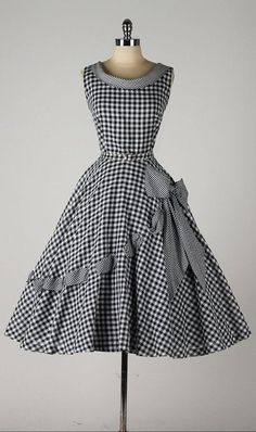 vintage 1950s dress ~ black & white gingham cotton. I'm pinning forth the asymmetrical ribbon in the skirt.